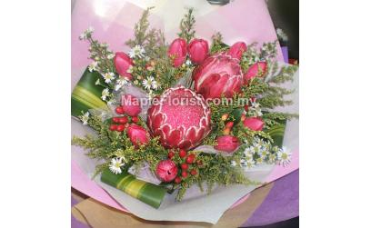 2 Protea flowers with 10 tulips bouquet